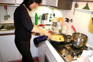 Anna Maria cooks rombo in her Venice kitchen.