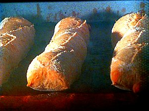 French bread loaves baking at Paul in Somerville