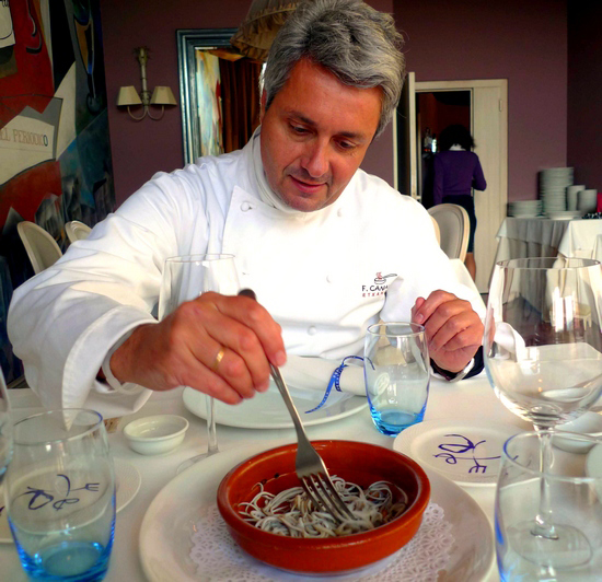 Fernando Canales stirs angulas in a cazuela in Restaurante Etxanobe in Bilbao
