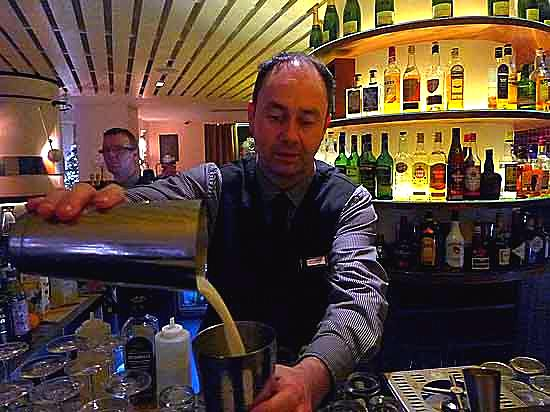 Gary Campbell mixes whiskey in a jar in Quay 14 in Dublin