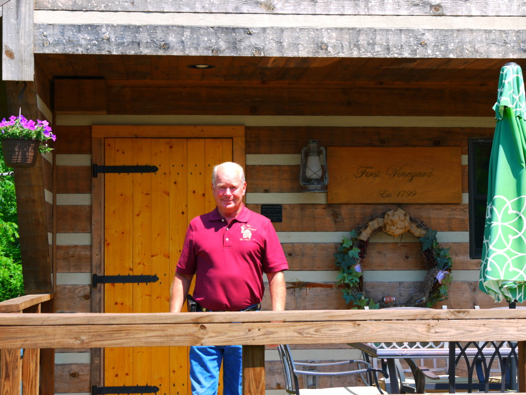 Tom Beall on porch of tasting room at First Vineyard