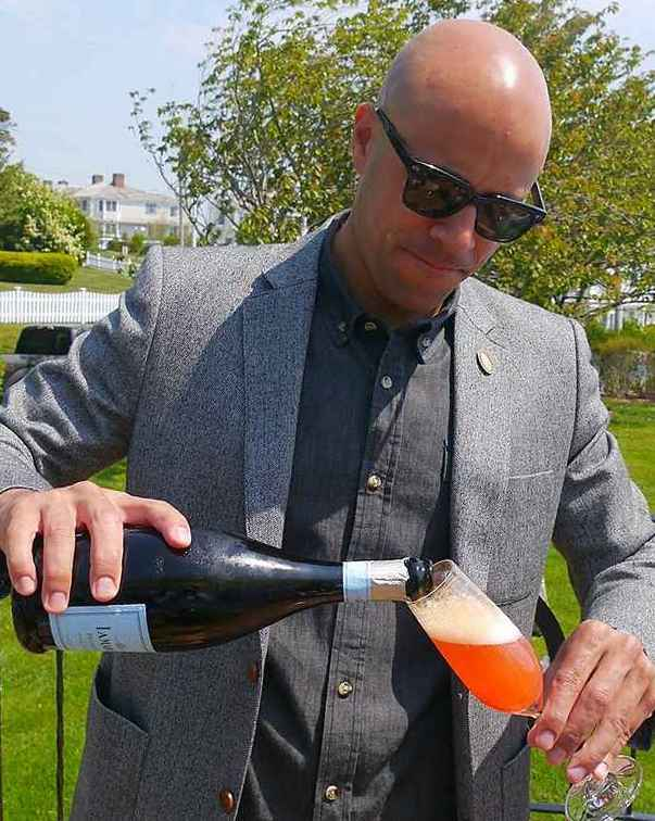 Carlton McCoy pours Blood Orange Mimosa at Lexus Gran Fondo