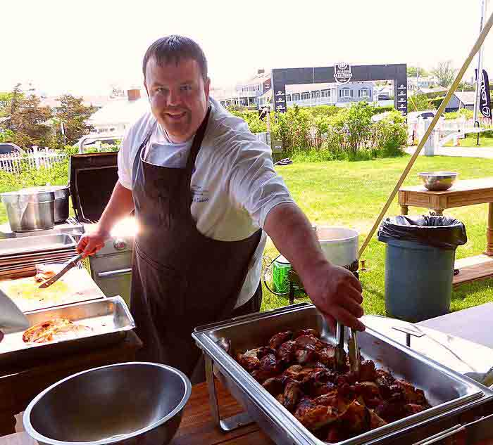 Andrew Chadwick grills chicken at Lexus Gran Fondo finish line cookout