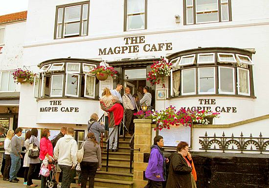 Diners wait to enter the Magpie Café in Whitby, United Kingdom