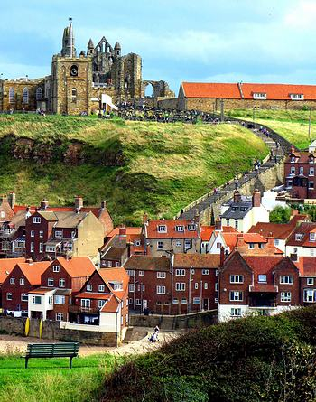Ruins of a medieval abbey loom above the village of Whitby in North Yorkshire, home of Magpie Cafe