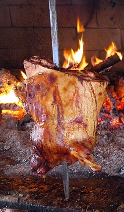 roasting meat at Camisadu