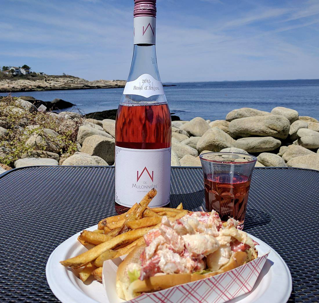 Rosé d'Anjou with lobster roll at Lobster Pool on Folly Cove in Rockport, Mass.