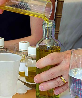 pouring olive oil after blending