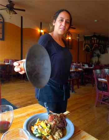 Loubna Ghoulam lifts cover on lamb tagine at Alia in Winthrop