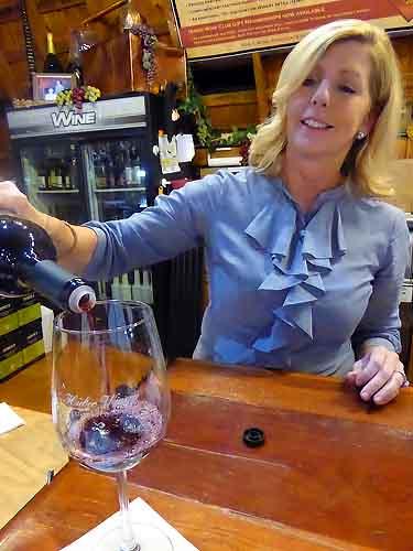 Dana Huber pouring cabernet franc