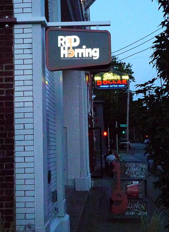 Louisville's Red Herring at night