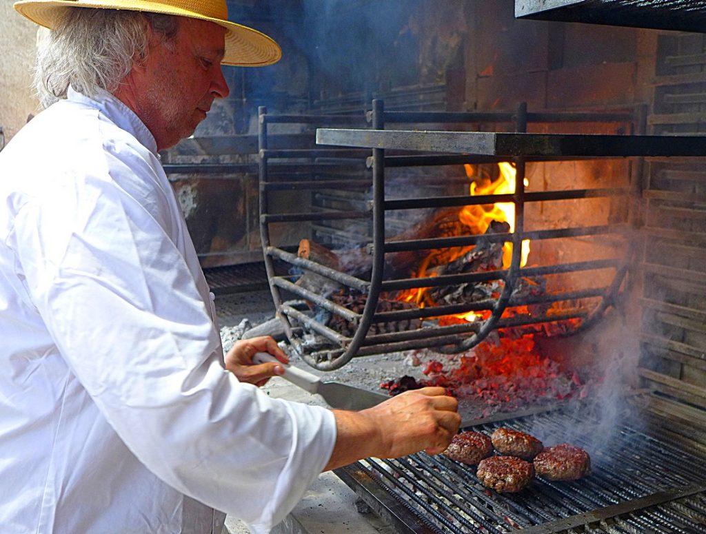 Francis Mallmann cooks hamburgers at Siete Fuegos