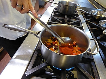 making achiote sauce at Occidental Cozumel