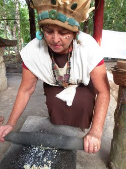 grinding corn at Pueblo del Maiz