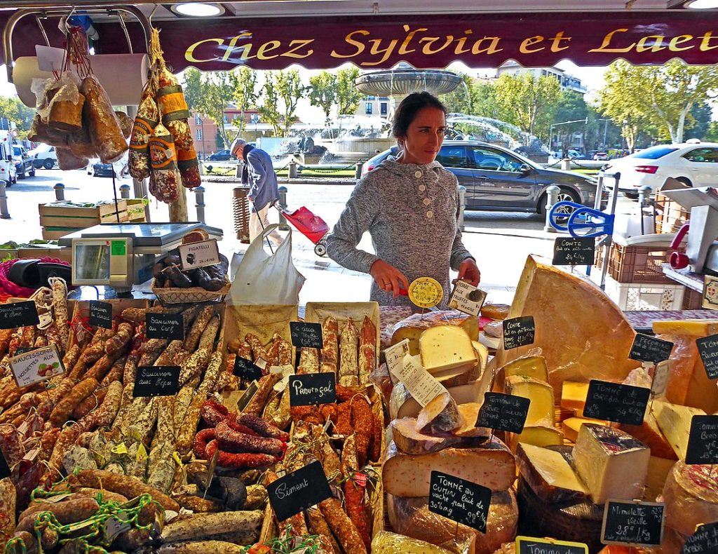 sausages and cheese at gourmet market in Aix-en-Provence