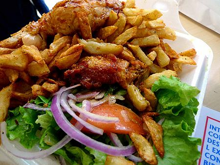 Rôtisserie Romados serves generous helpings of roast chicken, fries, and salad.