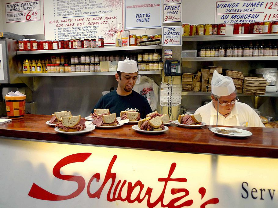 Cooks at Schwartz's turn out a steady stream of smoked meat sandwiches to meet what seems like an insatiable demand.