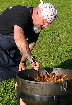 Brian Alberg stirs the pot at Shaker dinner