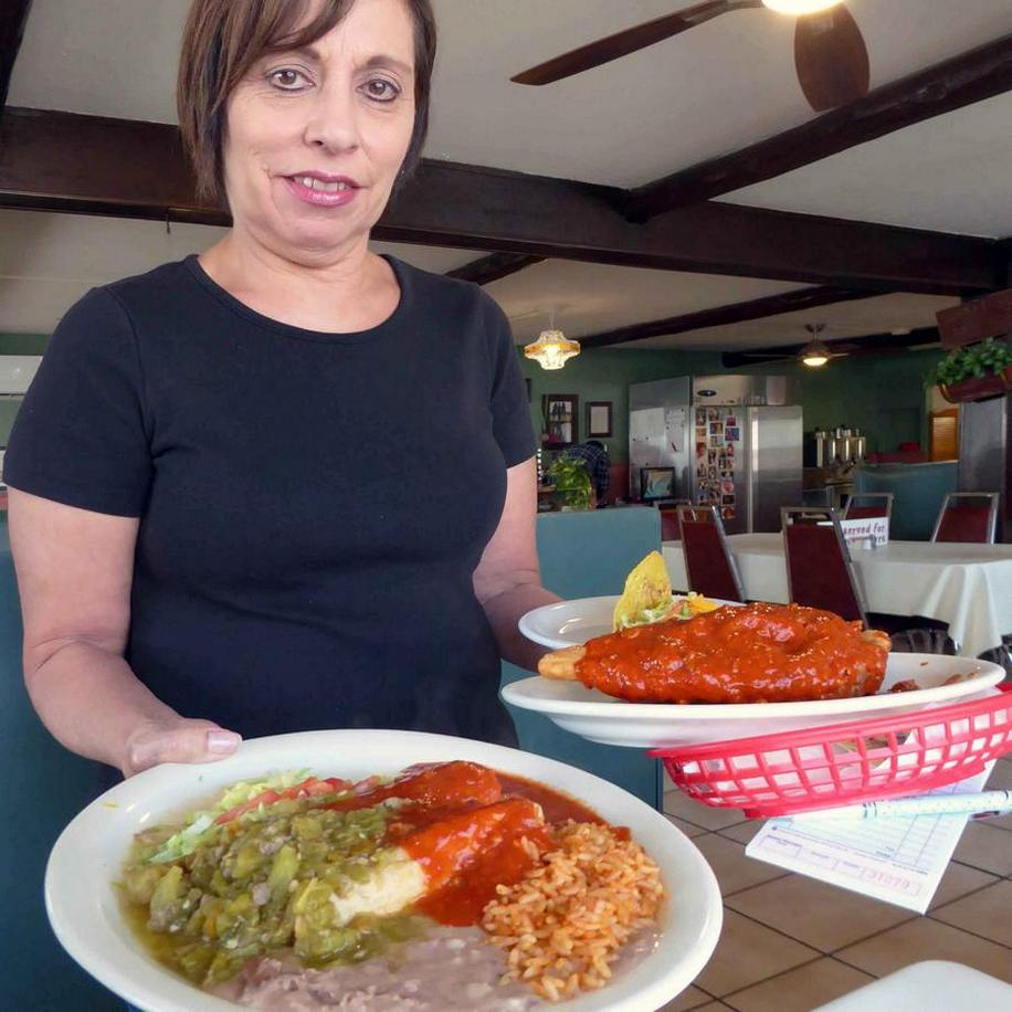 waitress delivers dishes at Mary and Tito's in Albuquerque, N.M.