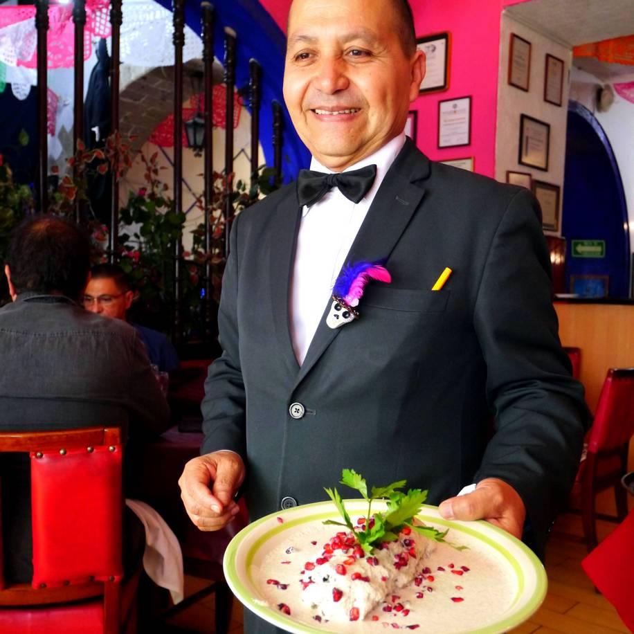 witer with chiles en nogada at  Hostería de Santo Domingo